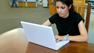 A student working at a laptop